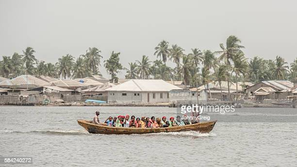 Crowd of people take a ferry boat across Lagos Creek