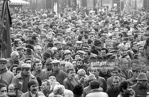 A crowd of people taking part in a demonstration for the victims of the Train 904 bombing also known as Christmas massacre Bologna December 1984