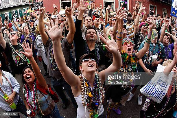 A crowd of people try to catch beads on Bourbon Street on Mardi Gras day February 5 2008 in New Orleans Louisiana Mardi Gras day or Fat Tuesday is a...