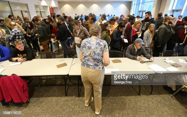A crowd of people wait in line at a polling center to vote in the midterm elections on November 6 2018 in Provo Utah Utah early voting has been...