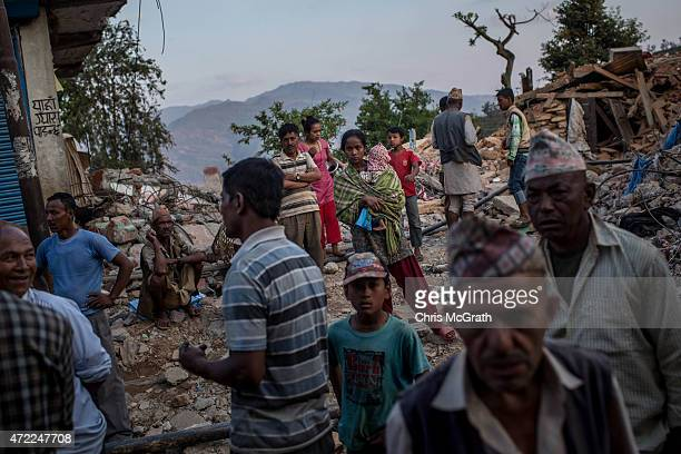 A crowd of people wait in the street as a truck carrying aid arrived in Dolalghat on May 5 2015 in Kathmandu Nepal A major 79 earthquake hit...