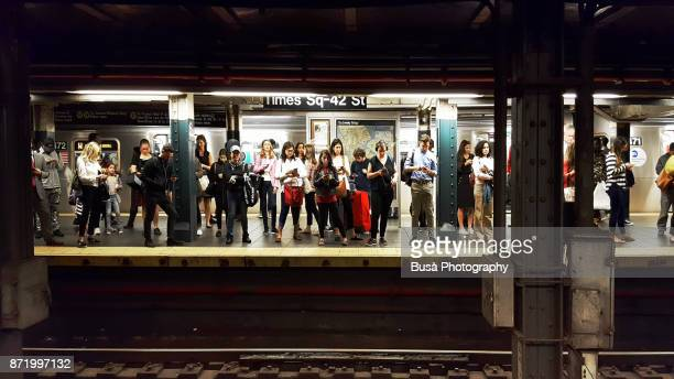 Crowd of people waiting for subway train at New York City's Times Square - 42nd Street Subway Station