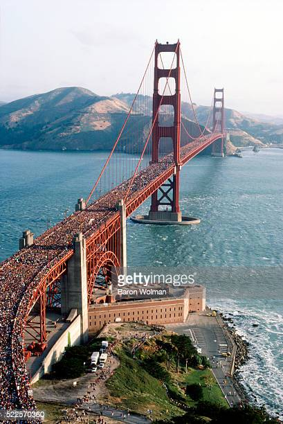 A crowd of people walk across the Golden Gate Bridge for it's 50th Anniversary San Francisco CA May 1987