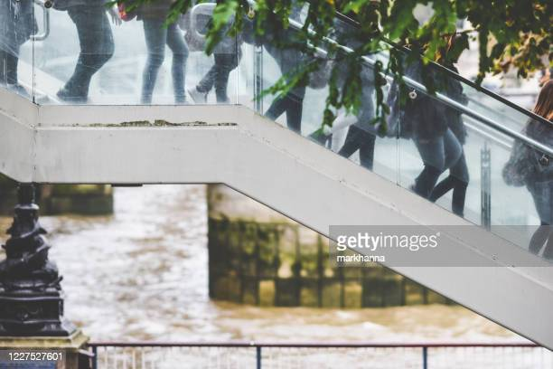 crowd of people walking down a staircase by river thames, london, england, uk - unknown gender stock pictures, royalty-free photos & images