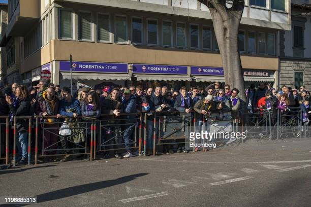 A crowd of people watch Rocco Commisso chief executive officer and founder of Mediacom Communications Corp greet other Fiorentina fans shortly before...