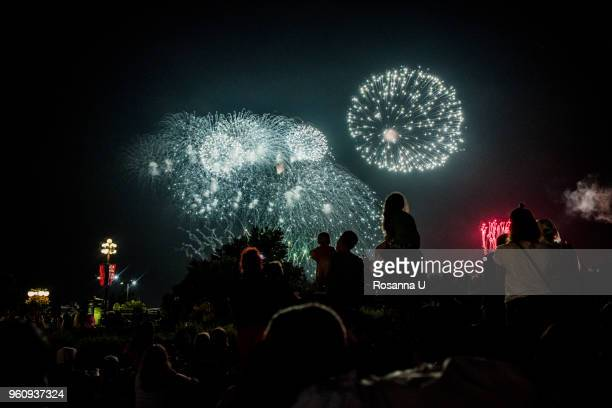 crowd of people watching canada day fireworks celebration outside the canadian museum of history, gatineau, quebec, canada - national holiday stock pictures, royalty-free photos & images