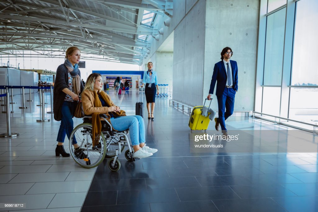 Crowd of people with luggage at international airport : Stock Photo