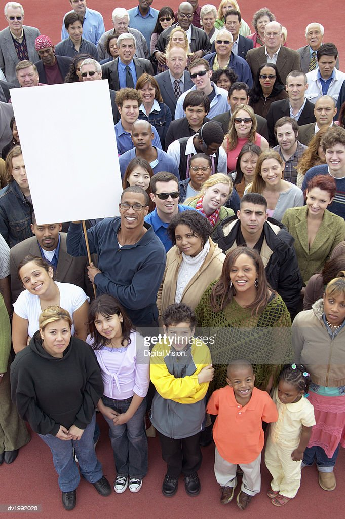 Crowd of People, with One Man Holding a Blank Placard : Stock Photo