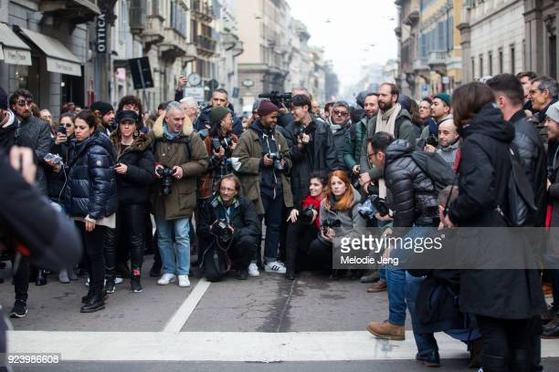 A crowd of photographers on the street await their next subject before Ermanno Srervino during Milan Fashion Week Fall/Winter 2018/19 on February 24...