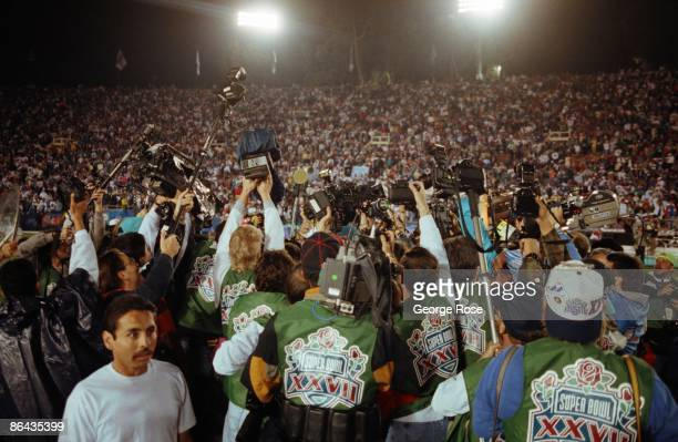 A crowd of photographers surround the winning coaches as seen in this 1993 Pasadena California Superbowl XXVII photo of a Dallas Cowboys win over the...