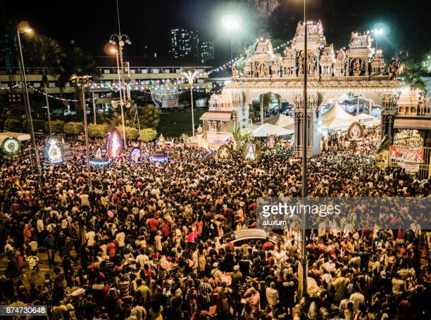 Crowd of pilgrims at night during the Thaipusam festival Malaysia