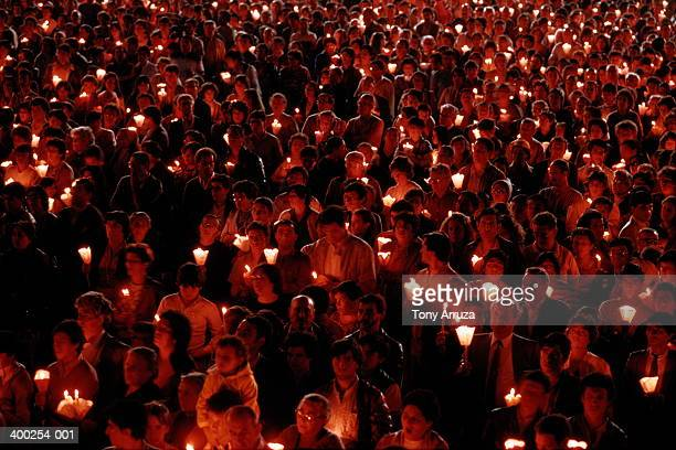 Crowd of pilgrims at religious site holding candles,Fatima,Portugal