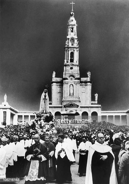 Crowd Of Pilgrims Being Led To The Cathedral Of Fatima In Portugal By The Bishop Of The City In The 1940S1950S