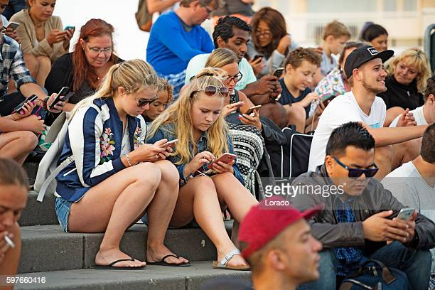 crowd of pokemon go players on smartphones in the netherlands - addict stock photos and pictures