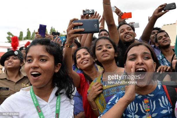 A crowd of private college students gather and take photographs of Indian Bollywood actors Akshay Kumar and Tamannaah Bhatia as they arrive for the...