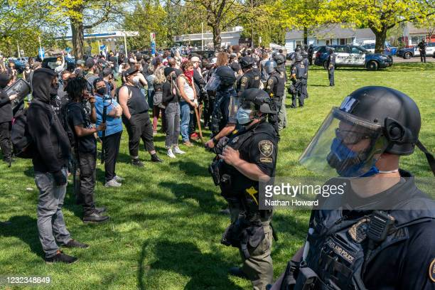 Crowd of protesters surrounds the scene of a police shooting in Lents Park on April 16, 2021 in Portland, Oregon. The shooting comes amid heightened...