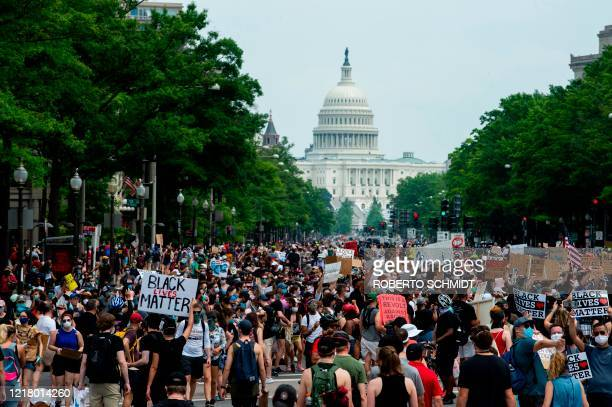 TOPSHOT A crowd of protesters walk from the Capitol building to the White House during a peaceful protest against police brutality and racism on June...