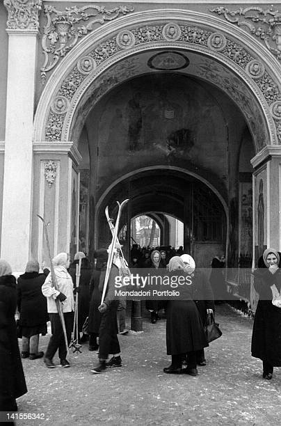 A crowd of Russian worshippers standing under an arch of the Trinity Lavra of St Sergius in Zagorsk today Sergiev Posad Zagorsk February 1960
