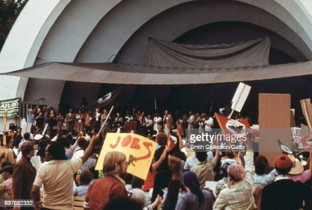 A crowd of senior citizens stopped to hear speeches at a rally to protest inflation unemployment and high taxes Lake Shore Drive Chicago Illinois...