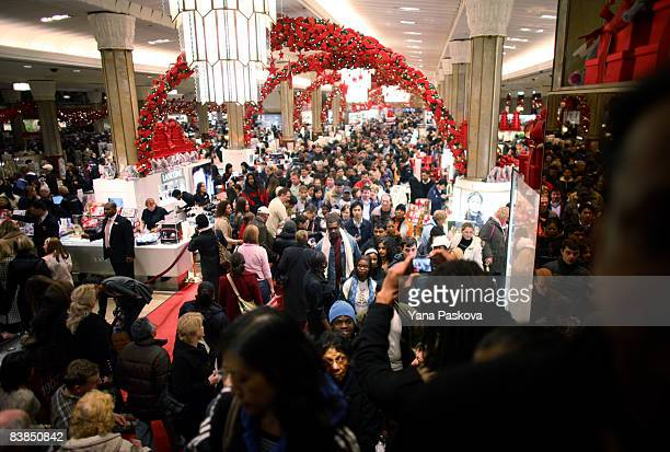 A crowd of shoppers hunt for bargains at Macy's on November 28 2008 in New York City The day after Thanksgiving often referred to as Black Friday is...