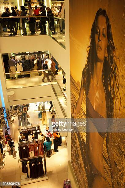 A crowd of shoppers line up to make purchases at the new HM store in Manhattan Hanging from a wall above the shoppers is a largerthanlife...