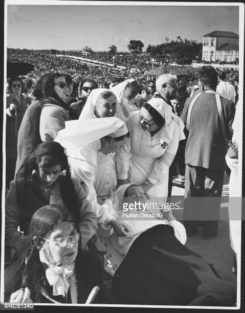 A crowd of sick pilgrims wait for the Papal Legate's Benediction during a pilgrimage to Fatima Here Our Lady appeared to three shepherd children 35...