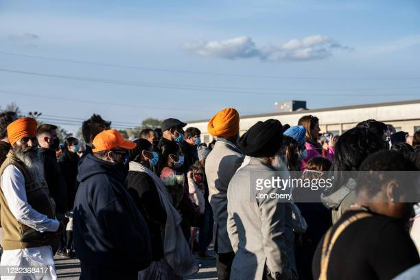 Crowd of Sikh citizens gather during a vigil to mourn the eight murdered FedEx Ground employees at Krannert Park on April 17, 2021 in Indianapolis,...