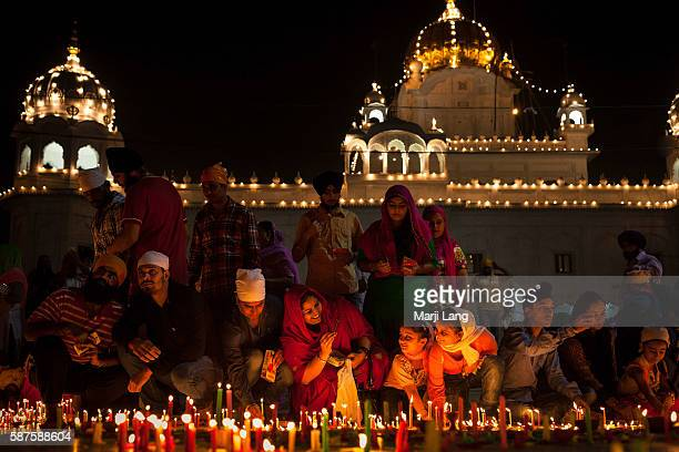 Crowd of Sikh devotees celebrating Diwali festival night also Bandi Chhor Divas celebration for the Sikh religion followers at the Gurdwara Dukh...