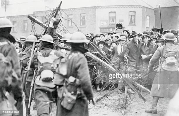 A crowd of Sinn Fein sympathizers in front of a barricade manned by British troops barring the road to Mountjoy prison Dublin 30th April 1920