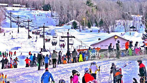 Crowd of skiers on mountain slopes