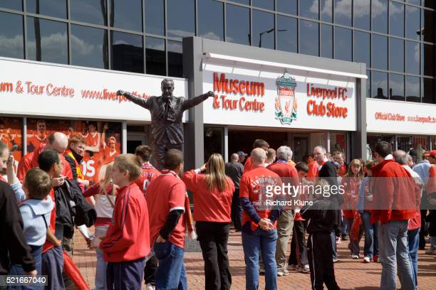crowd of soccer fans outside liverpool fc museum - liverpool f.c. photos stock pictures, royalty-free photos & images