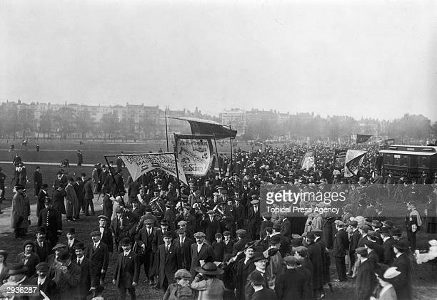 A crowd of socialists with banners and a brass band gathered for a Labour Day demonstration in Hyde Park London 1st May 1913