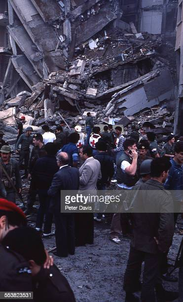 Crowd of soldiers and aid givers stand amid the destruction and damage at the scene of the suicide bombing of the American Embassy, Beirut, Lebanon,...