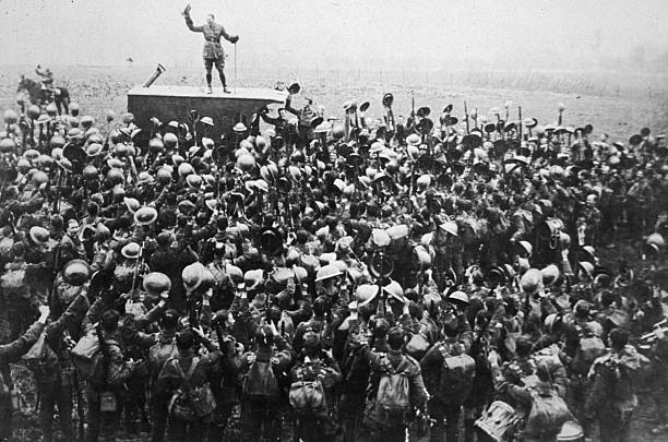 1918, A crowd of soldiers on the Western Front celebrating...