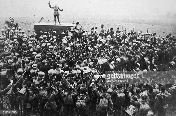 1918 A crowd of soldiers on the Western Front celebrating as an officer announces the news of the armistice