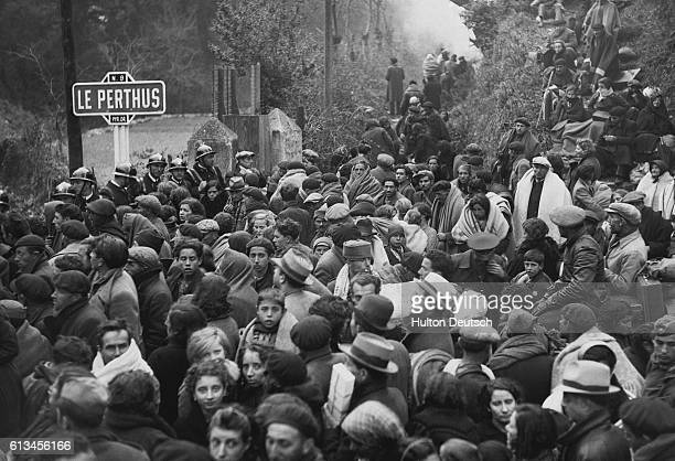 Crowd of Spanish refugees made homeless by the Civil War fill the road to Perpignan at Le Perthus in France.