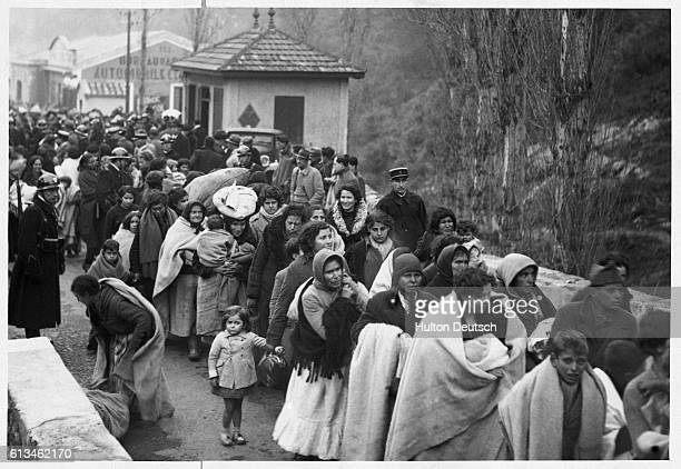Crowd of Spanish women and children refugees mad homeless by the civil war cross the border into France at Le Perthus.