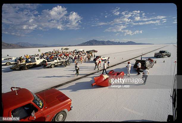 A crowd of spectators and drivers gathers at the Bonneville Flats starting line prior to a Sunday qualifying run