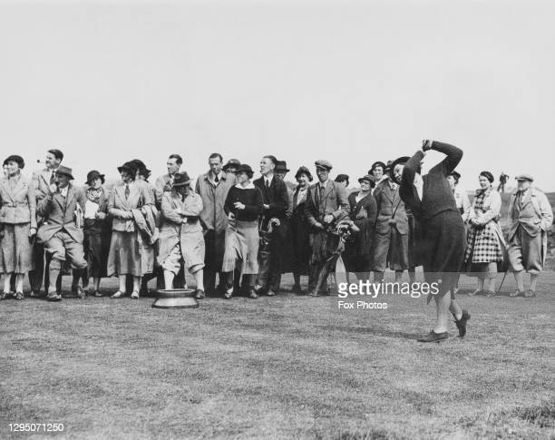 Crowd of spectators watch as Pauline Doran drives off the 6th tee during the Women's Open Golf Championship on 15th May 1936 at the Southport and...