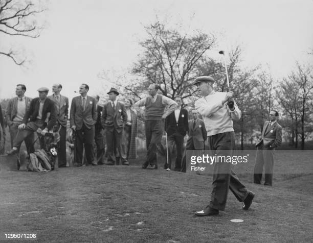 Crowd of spectators watch as W D Smithers drives off the 2nd tee during the Silver King Golf Tournament on 22nd April 1950 at the Moor Park Golf Club...
