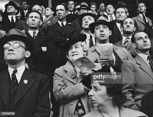 A crowd of spectators watching a greyhound race at a track in Brighton 12th August 1939 Original publication Picture Post 171 Brighton pub 1939