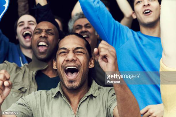 crowd of sports fans cheering - sports event stock pictures, royalty-free photos & images