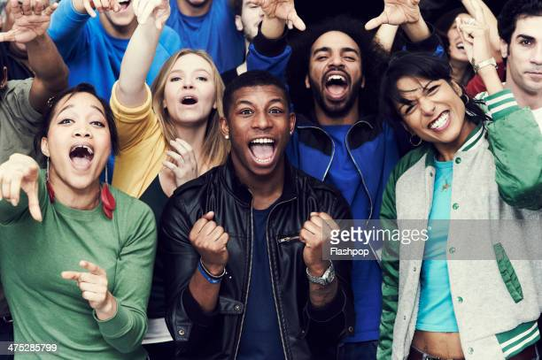 crowd of sports fans cheering - chanting stock pictures, royalty-free photos & images