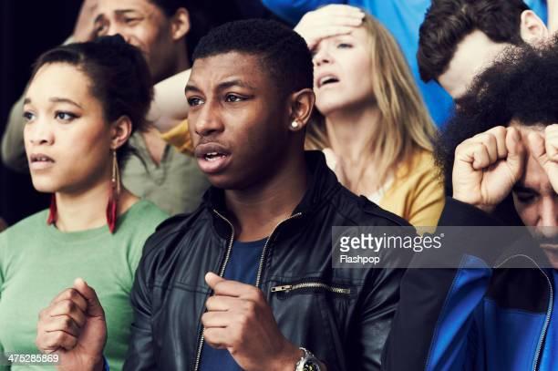 crowd of sports fans cheering - sportevenement stockfoto's en -beelden