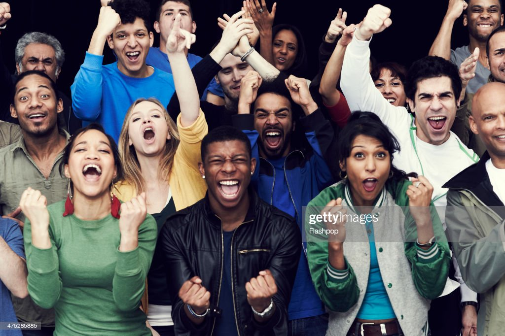 Crowd of sports fans cheering : Stock Photo