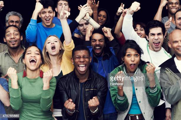 crowd of sports fans cheering - multiracial group stock pictures, royalty-free photos & images