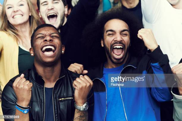 crowd of sports fans cheering - opwinding stockfoto's en -beelden