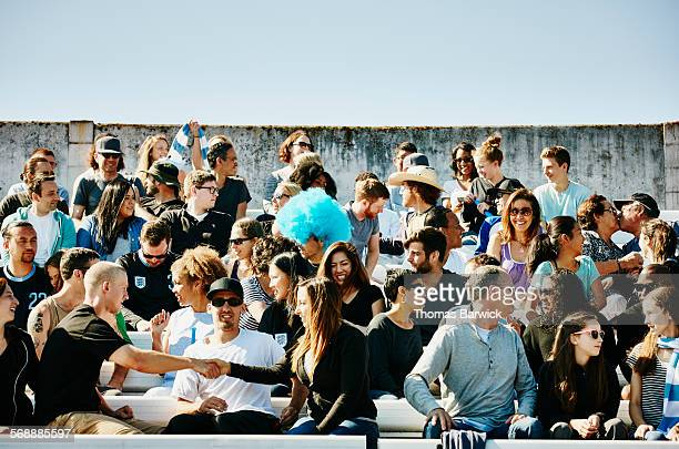 crowd of sports fans sitting in stadium - large group of people stock pictures, royalty-free photos & images
