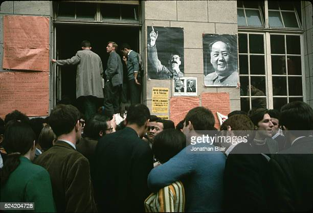 A crowd of students protest outside a University of Paris building in the Latin Quarter under posters of Mao and Stalin In May of 1968 Paris was...