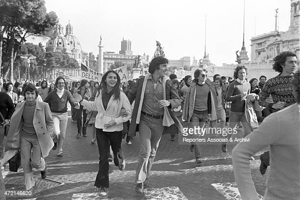 'A crowd of students running towards Piazza Venezia during a demonstration for school reform Rome 1973 '